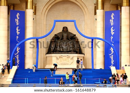 ULAANBAATAR, MONGOLIA - JULY 2013: People around Genghis Khan Statue, Sukhbaatar Square - stock photo