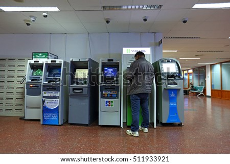 ULAANBAATAR, MONGOLIA - SEP 24: ATM machine located in the Ginggis Khaan International Airport in Ulaanbaatar on September 24, 2016. it is the international airport in Mongolia