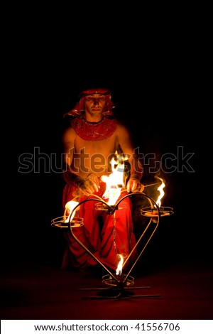 ULAN-UDE, RUSSIA - JUNE 26: A circus artist performs a number with fire on June 26, 2009 in Ulan-Ude, Buryatia, Russia.