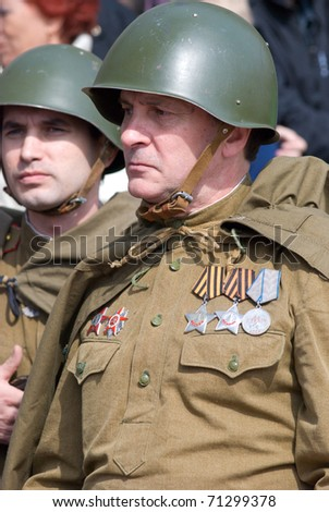 ULAN-UDE, RUSSIA - MAY 9: A group of actors wearing vintage (WWII's period) uniforms wait for their perform on annual Victory Day, May, 9, 2009 in Ulan-Ude, Buryatia, Russia. - stock photo