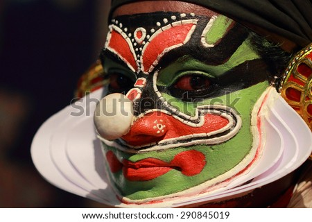 ULLANNOOR, INDIA - FEB 11: An unidentified Kathakali artist looks as he does make-up before the  on-stage performance during a temple festival on February 11, 2015 in Ullannoor, Kerala,India.  - stock photo