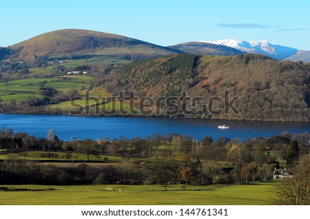 Ullswater steamer travelling towards Pooley Bridge in the Lake District National Park Cumbria England - stock photo