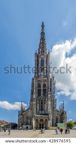 ULM, GERMANY - MAY 26, 2016: people visit Ulm Minster  in Ulm, Germany. Ulm Minster is the tallest church in the world with height 161.5 metres (530 ft).