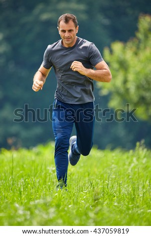 Ultra distance marathon runner training in the forests - stock photo