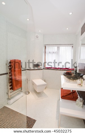 Ultra Modern Bathroom in Stark White with Orange Accent