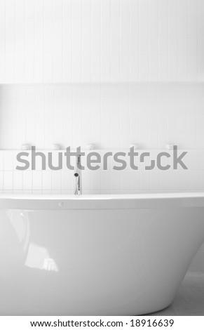 Ultra Modern Bathroom with Stark White Ceramic Tiles - stock photo