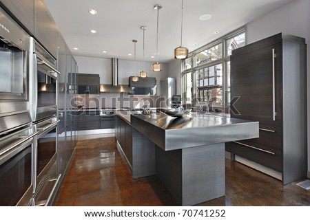 Ultra modern kitchen with stainless steel island - stock photo