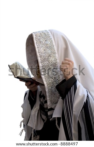 Ultra-orthodox in tallite, that is prayed against the white background in Jerusalem. - stock photo