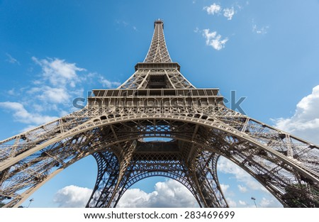 Ultra wide angle of Eiffel Tower over blue sky in Paris, France. Bottom-up view - stock photo