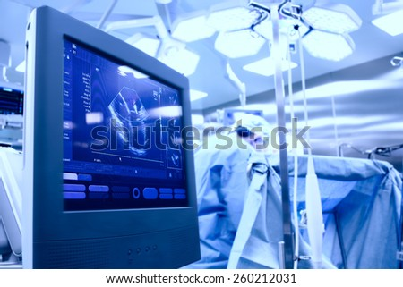 Ultrasound in the operating room during surgery - stock photo