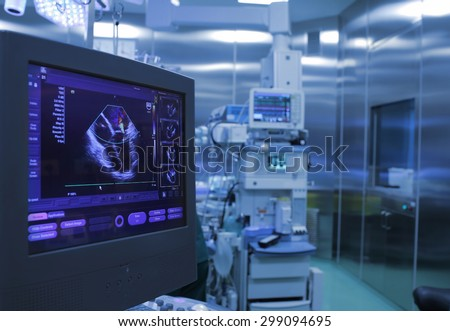 Ultrasound monitoring of the heart during surgery in operating room - stock photo