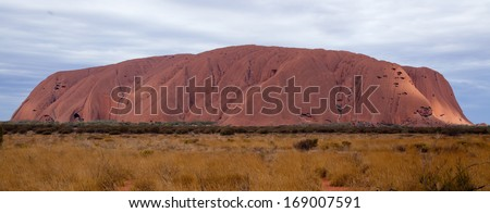 Uluru - Ayers Rock. Aboriginal sacred place. UNESO world heritage. Sunrise sun is color painting red sandstone rock.