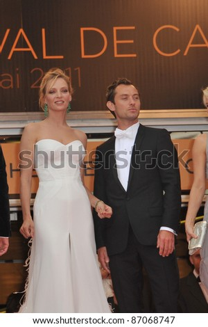 """Uma Thurman & Jude Law at the gala premiere for """"Midnight in Paris"""" the opening film at the 64th Festival de Cannes. May 11, 2011  Cannes, France Picture: Paul Smith / Featureflash - stock photo"""