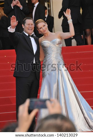 Uma Thurman & partner Arpad Busson at the closing awards gala of the 66th Festival de Cannes. May 26, 2013  Cannes, France