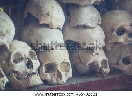 Uman skulls of victims of the Khmer Rouge memorial in Phnom Penh, Cambodia. - stock photo