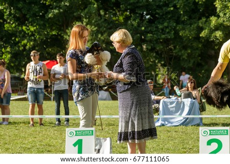 UMAN, UKRAINE -12June 2017: International Dog Show. Participants of dog competition show their pets in accordance with competitive program. Rewarding of dogs. Competition of exterior of breeds of dogs