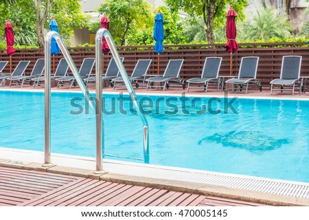 Umbrella and chair around Outdoor swimming pool in hotel and resort