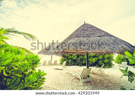 Umbrella and chair n Beautiful tropical Maldives island resort with beach and sea for nature holiday vacation background concept - Vintage Filter and Boost up color Processing