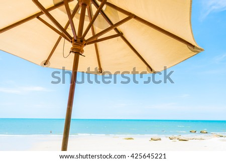 Umbrella and chair nearly beach and sea - Boost up color Processing