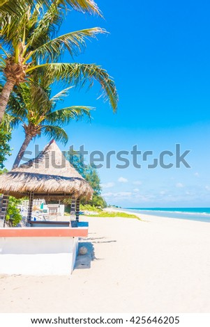 Umbrella and chair on beautiful tropical beach and sea - Boost up color Processing - Holiday vacation concept background