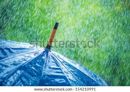 umbrella and rain drops closeup - stock photo