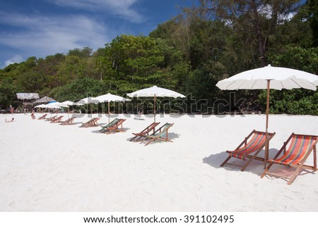 Umbrella and twin chairs on a beautiful tropical beach. - stock photo