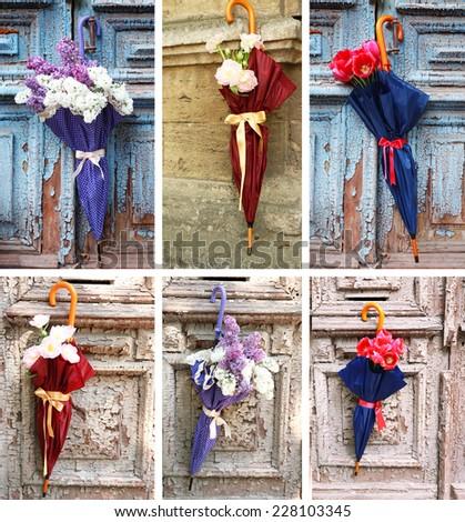 Umbrella concept. Beautiful flowers in umbrella on old wooden doors - stock photo
