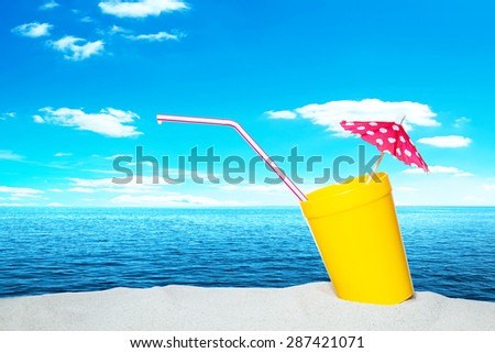 Umbrella drink on the beach