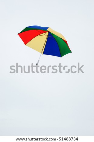 umbrella flying in the air - stock photo