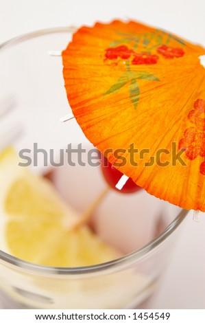 Umbrella in a tropical drink. Very shallow DOF, selective focus on area of umbrella. - stock photo