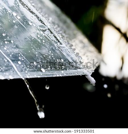 Umbrella in the rain in vintage tone - stock photo