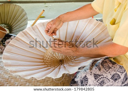 umbrella made of paper crafts of the village Bo Sang, Chiang Mai Thailand. - stock photo