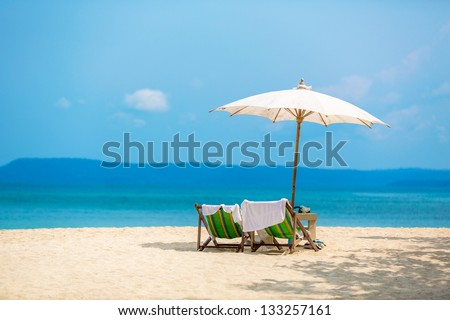 umbrella on a tropical beach - stock photo