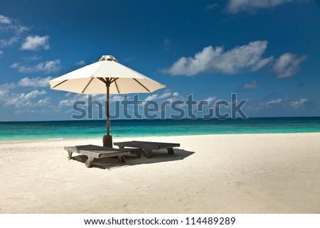Umbrella on the beach. - stock photo