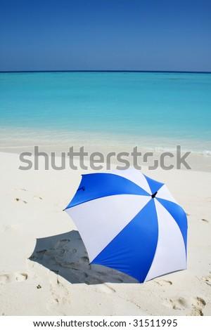 umbrella on the beach - stock photo
