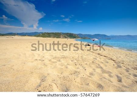 Umbrella on the beach, Corsica, France - stock photo