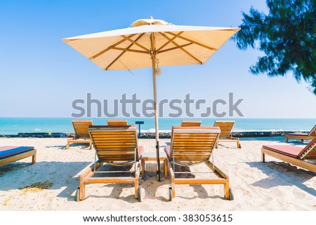 Umbrella pool and chair in luxury hotel pool resort on the beach - Filter Processing style