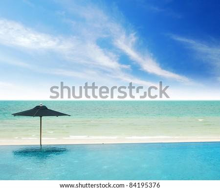 Umbrella relax beach sea sand sun thailand relaxation blue sky travel - stock photo