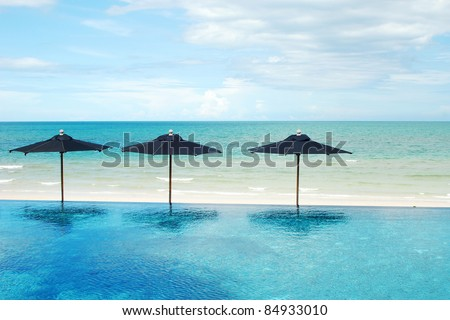 Umbrella relax beach sea sand sun thailand relaxation blue sky travel together three - stock photo