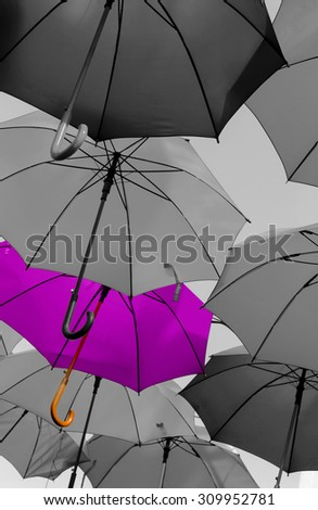 umbrella standing out from the crowd unique concept - stock photo
