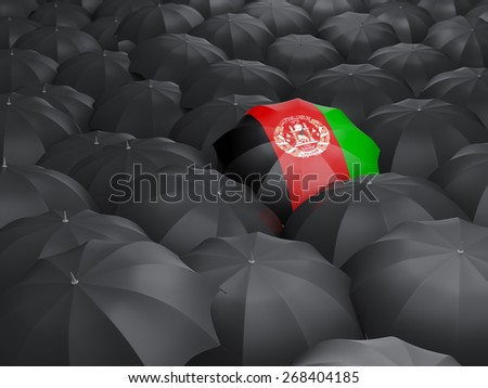 Umbrella with flag of afghanistan over black umbrellas - stock photo