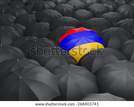 Umbrella with flag of armenia over black umbrellas - stock photo