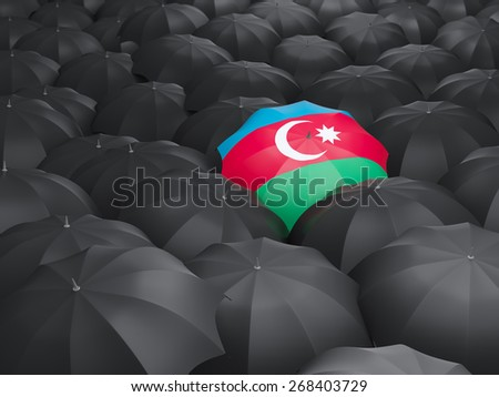 Umbrella with flag of azerbaijan over black umbrellas - stock photo