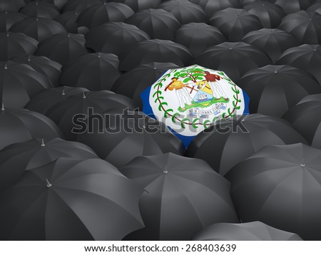Umbrella with flag of belize over black umbrellas - stock photo