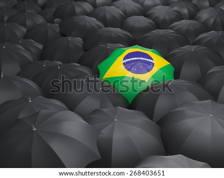 Umbrella with flag of brazil over black umbrellas - stock photo