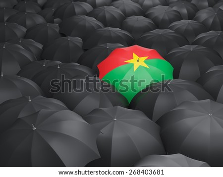 Umbrella with flag of burkina faso over black umbrellas - stock photo