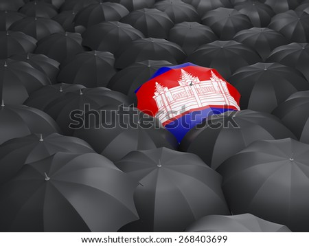 Umbrella with flag of cambodia over black umbrellas - stock photo