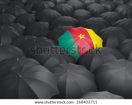 Umbrella with flag of cameroon over black umbrellas - stock photo