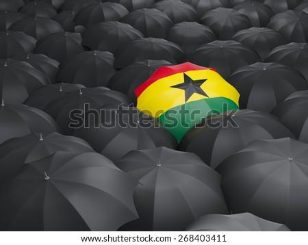 Umbrella with flag of ghana over black umbrellas - stock photo
