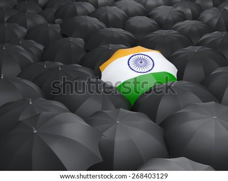Umbrella with flag of india over black umbrellas - stock photo